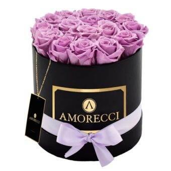 caja redonda negra y rosas